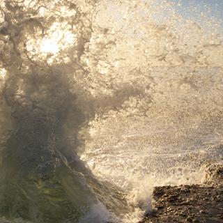Ocean Waves Against Rocks